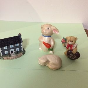 Four small ceramic ornaments as shown in photos